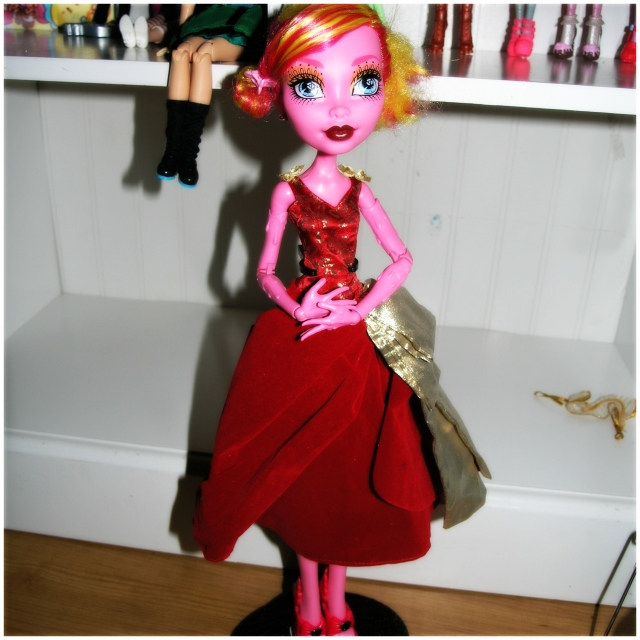A large portion of why I bought her is that she can wear some Barbie clothes. Took me a while to find a dress in my stash that looked good on her, but I quite like this one! I also put human-sized studs/earrings in (the fit quite well!) and tied her hair back in a tight bun.